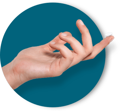 A hand holding a contact on tip of finger.