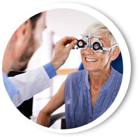A older woman getting her eyes checked.