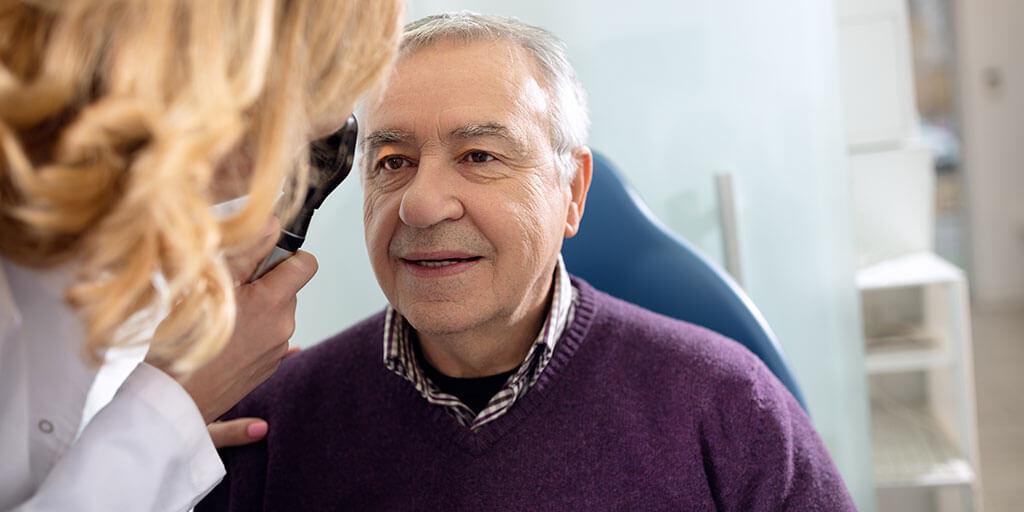Older man getting an eye exam